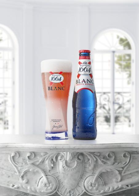 Kronenbourg 1664 Blanc noua bere rose in sticlă albastră marină